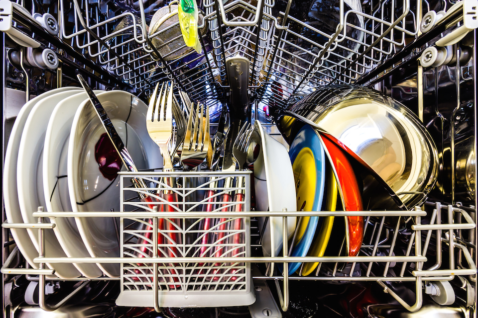 Dish washer full of clean dishes, colorful