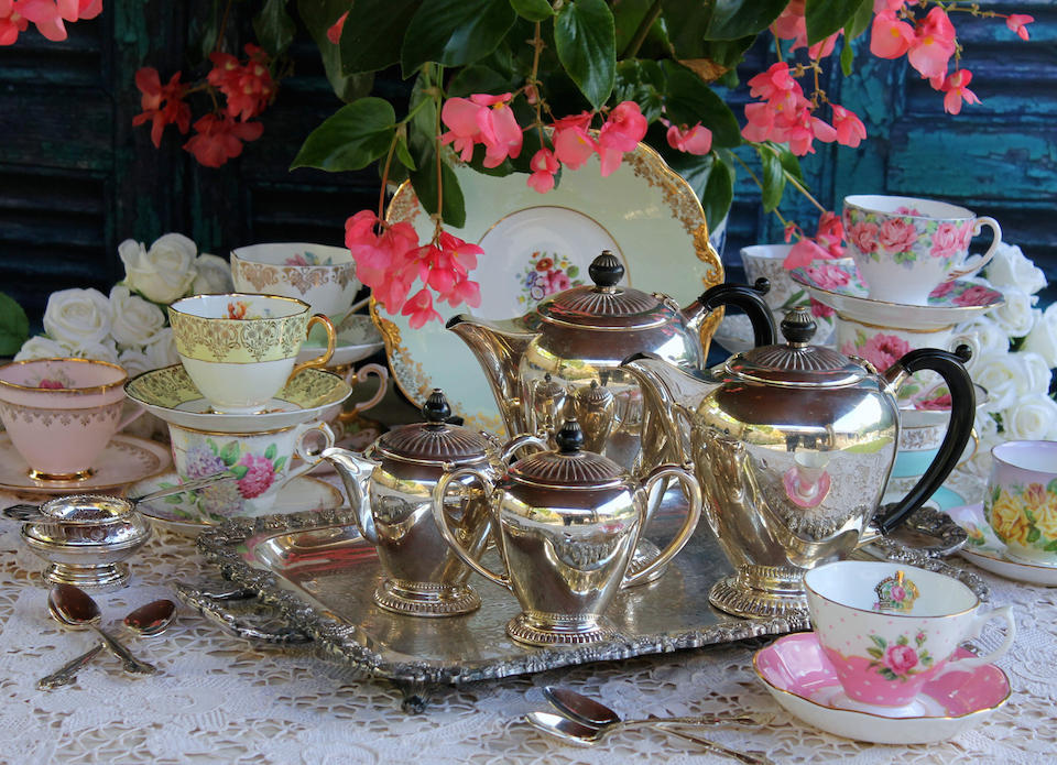 Vintage ornate silver tea set on tray with tea cups - formal afternoon high tea party