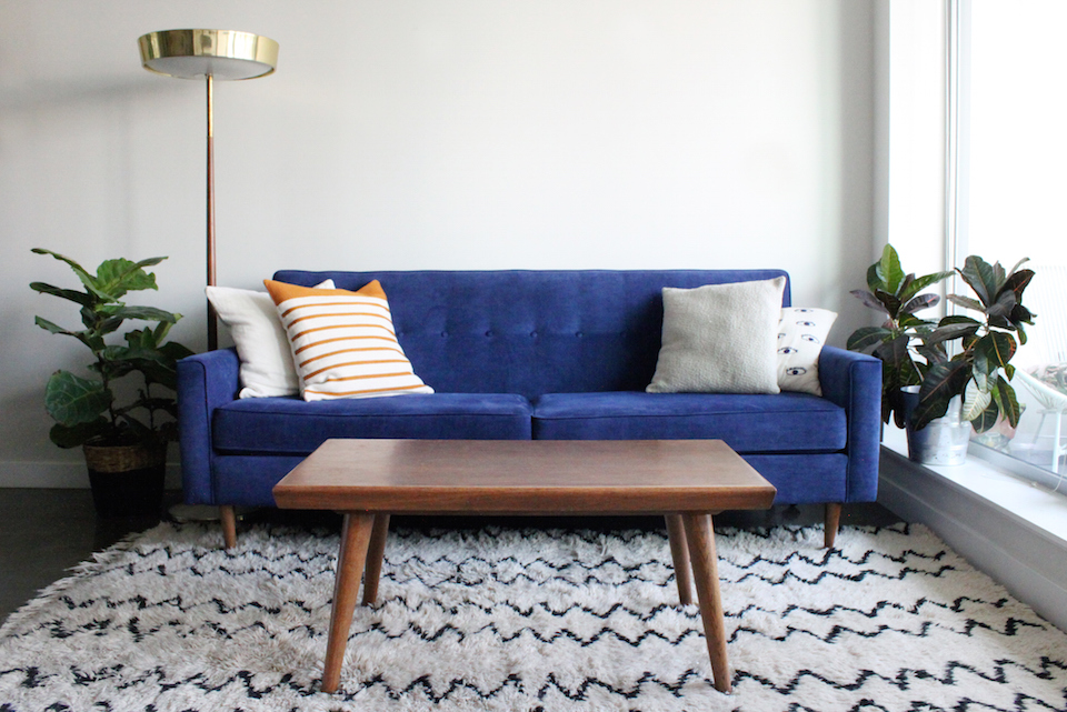Blue Suede Mid Century Modern Couch in Minimalist Apartment Setting