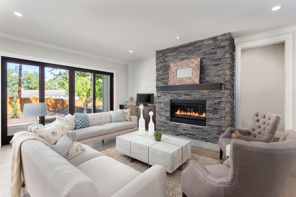 Beautiful living room interior with hardwood floors and fireplace in new luxury home.