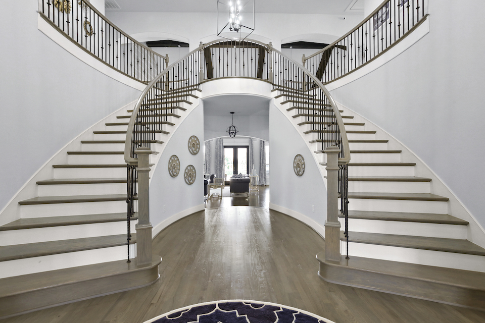 Double staircase entryway at 6300 Holbrook Circle in Parker, TX